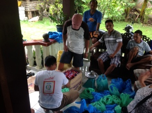 Neighbors who helped packing the goods.